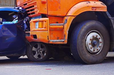 rollaway truck damages car
